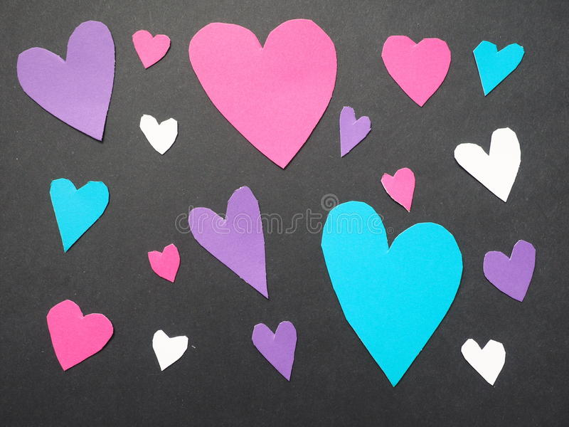 Hearts. Real cut out of paper hearts for your romantic or healthcare copy stock photo