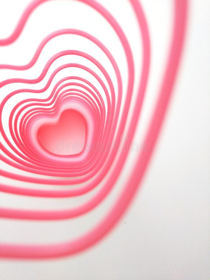 Hearts repeated. Pink sing of love royalty free stock images