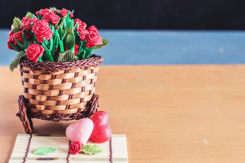 Hearts and roses on bamboo pots. stock photo