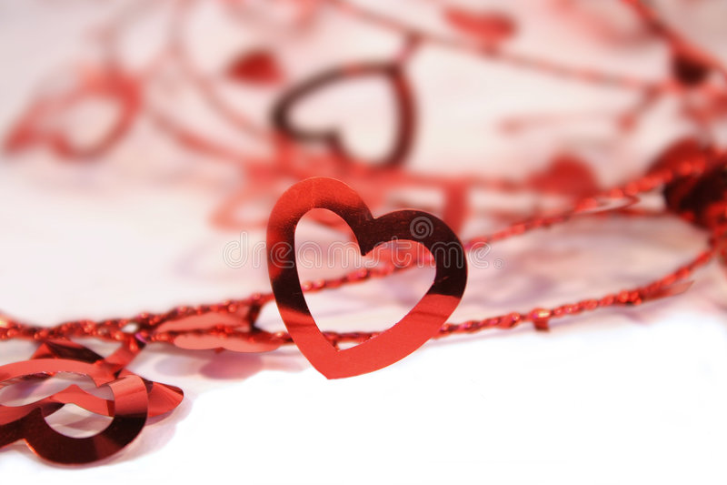 Hearts in a row. String of decorative hearts on white background stock images
