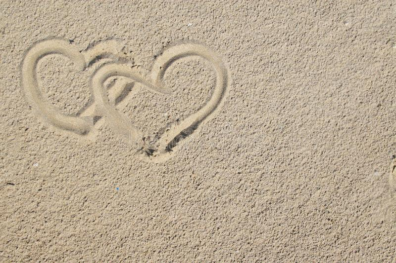 Hearts and sand royalty free stock photos