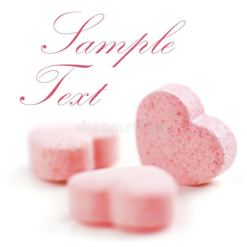Hearts shaped Sugar Pills. royalty free stock photos
