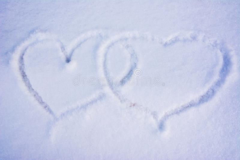 Hearts on the snow. The shape of heart on the snow. royalty free stock images