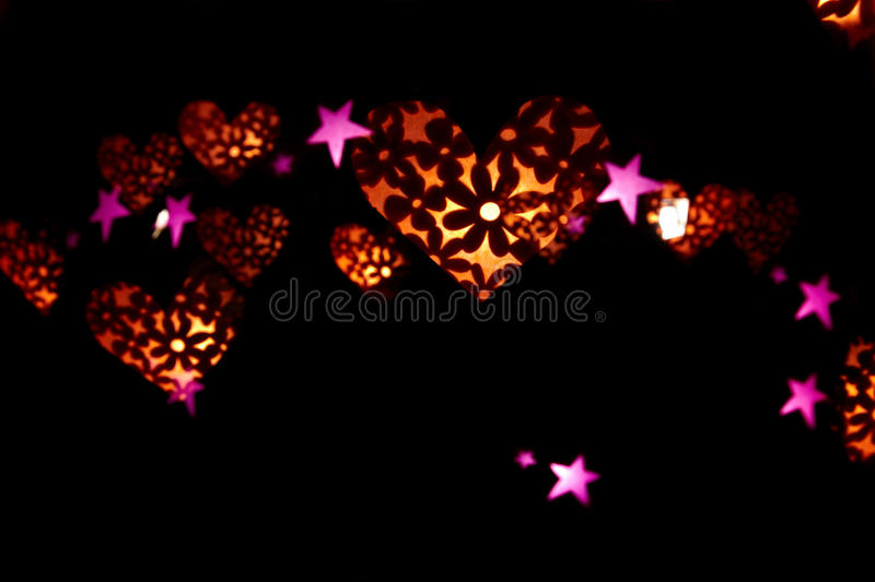 Hearts and stars made of light stock image