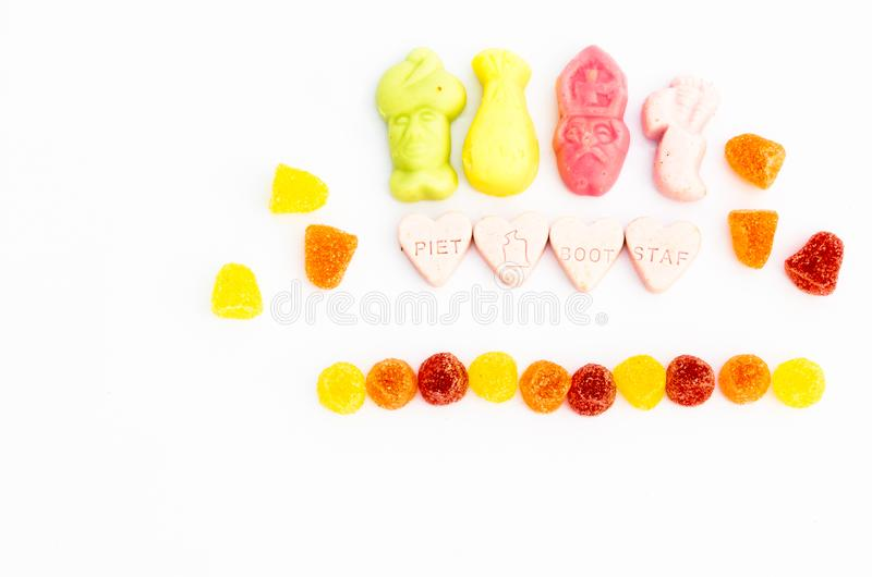 Hearts with text Piet, boat and staff. Surrounded by colored candies and meringues with space for text on a white background. Top stock photo