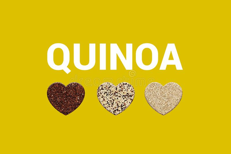 Hearts with three types of Peruvian grains. Red quinoa, blended quinoa and white quinoa on yellow background. Heart shapes with Text quinoa. Organic Vegan food stock photo