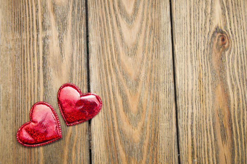 Hearts. Two hearts on a wooden background. Holiday background royalty free stock photos