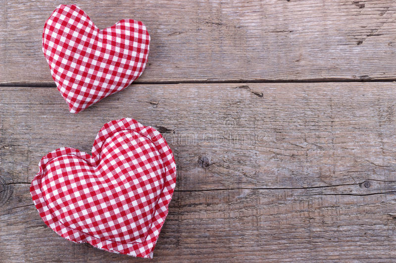 Hearts on wooden board, Valentines Day background royalty free stock photography
