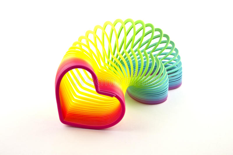 Heartshaped slinky. On a white background royalty free stock photo