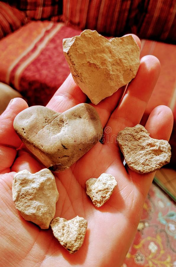 Heartshaped stones in hand royalty free stock photo