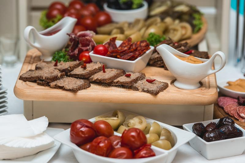 Hearty lard with garlic served with fresh bread on a table. stock image