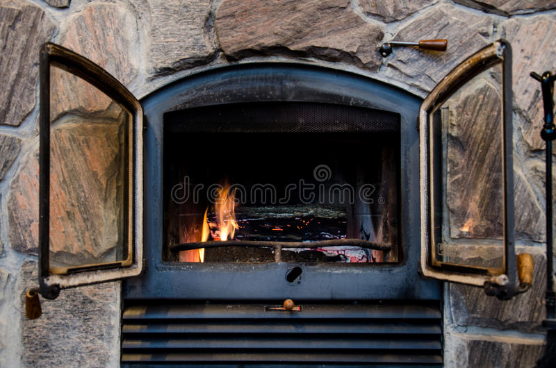 Download Fireplace In A Rustic Stone Chimney Stock Photo - Image: 28505944