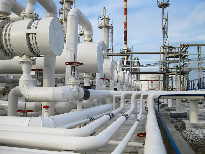Heat exchangers in refineries. The equipment for oil refining. Heat exchanger for flammable liquids. The plant for the primary pro stock photos