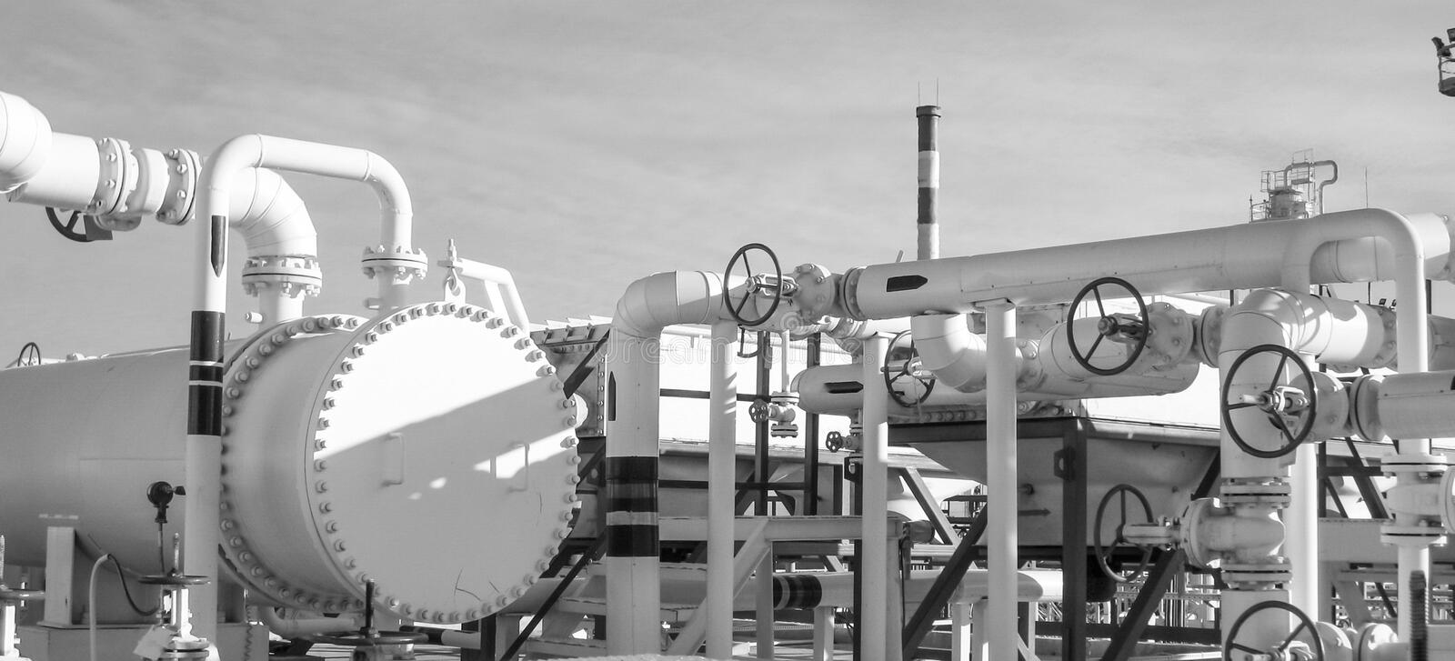 Heat exchangers in a refinery. The equipment for oil refining royalty free stock photography