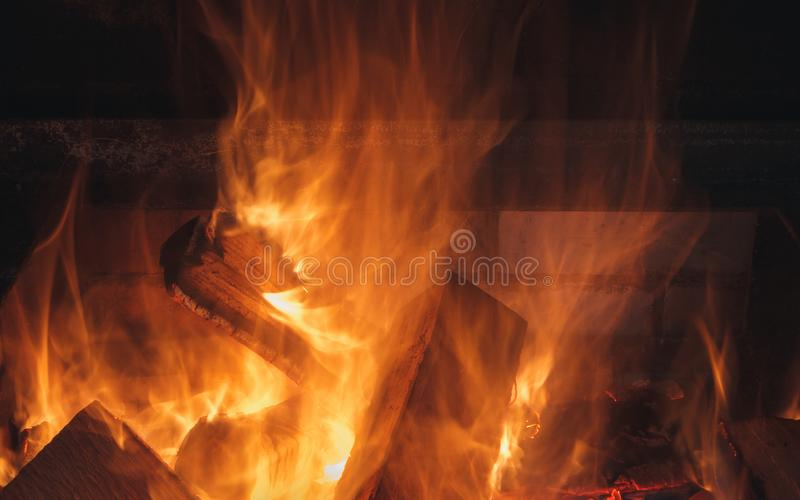 Heat from a flame of burning wood in the fireplace at night. royalty free stock photos