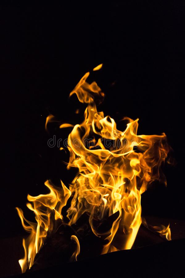 Heat of Hellfire. Devilish flame. The fire of hell. Background from dancing tongues of fire. Fire hazard. Fire safety. Passionate love. Bask around the campfire stock photo