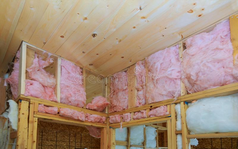 Heat isolation in a new house with mineral wool, home wood. Heat isolation in a construction and renovation new house with mineral wool, wood home fiberglass royalty free stock photography