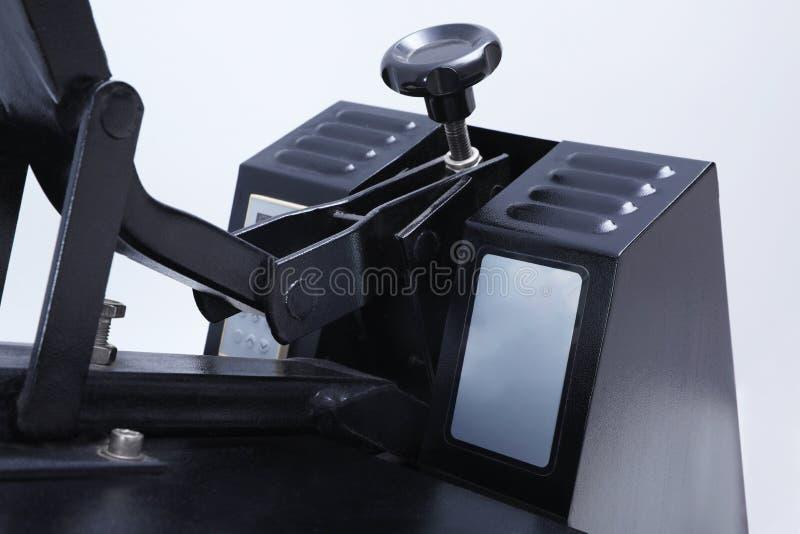 Heat press machine on light , closeup view. Heat press machine on light background, closeup view royalty free stock photography