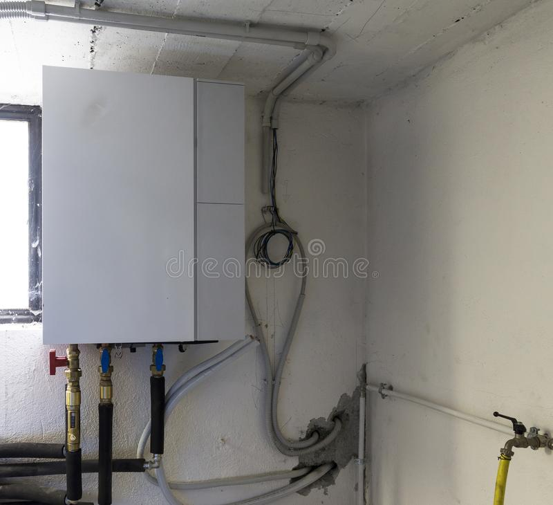 Heat pump air - water in the boiler room. Industrial: heat pump air - water in the boiler room royalty free stock images
