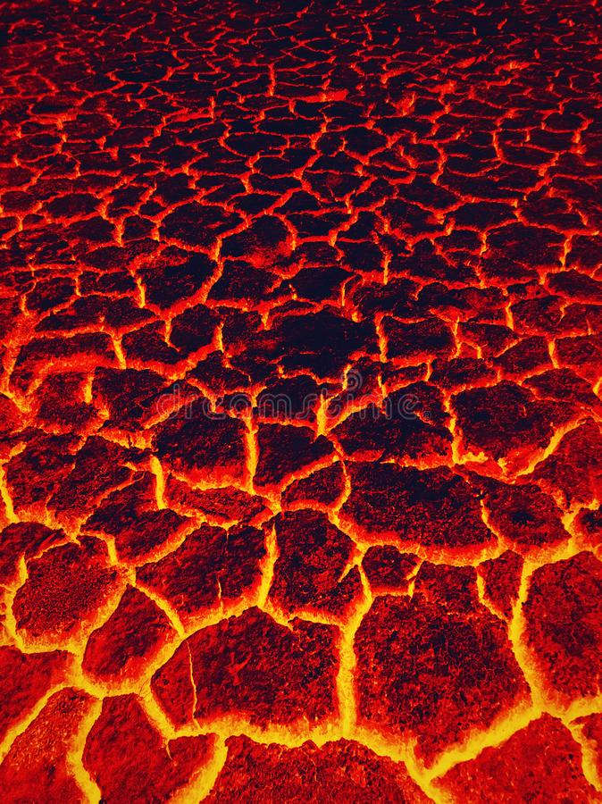 Heat red cracked ground texture burning after eruption volcano. Molten active lava texture background. Armageddon natural disaster. Or hell concept royalty free stock images