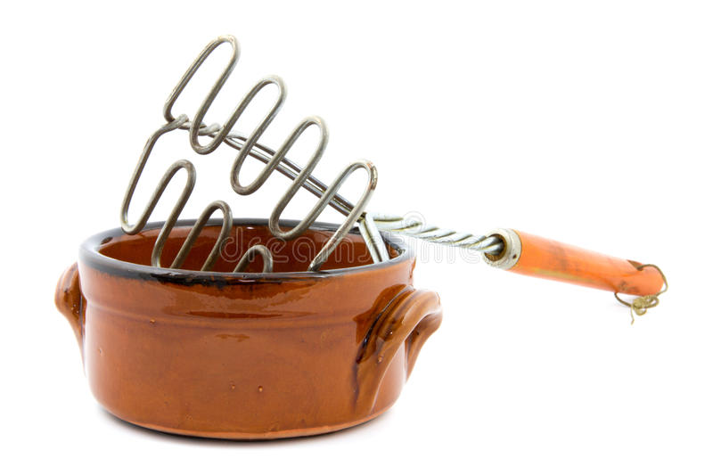 Heat resistant bowl with masher. Brown heat resistant bowl with masher royalty free stock image