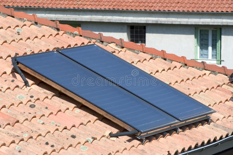Heat solar water. Installed on a roof of Anduze, French city in the south-east of France royalty free stock images