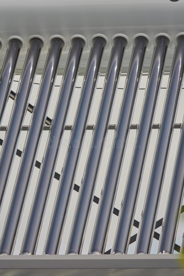 Heat transfer tubes - cor element of the solar water heater stock photos