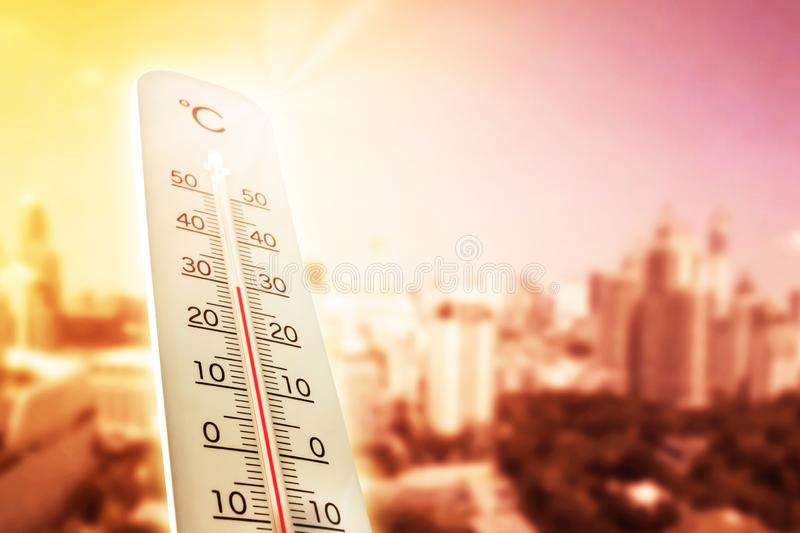 Heat wave in the city thermometer shows in summer royalty free stock photo
