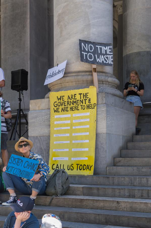 Heated Dialogue. Adelaide, AU - November 30, 2018: Hundreds of students in Adelaide gather outside of Parliament House demanding action on climate change royalty free stock photo