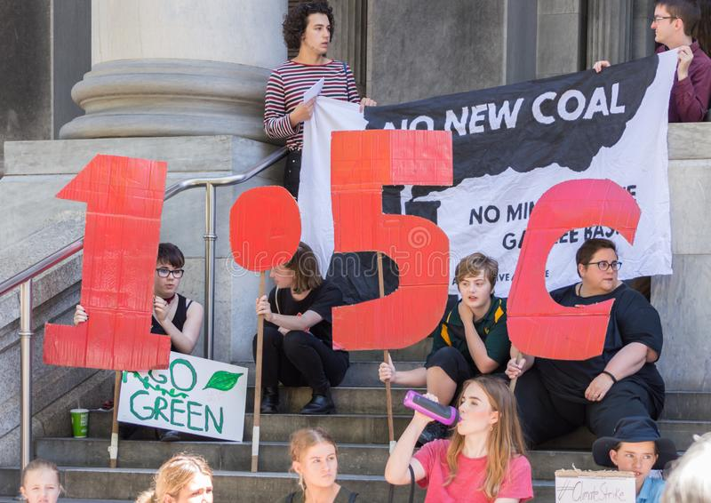 Heated Dialogue. Adelaide, AU - November 30, 2018: Hundreds of students in Adelaide gather outside of Parliament House demanding action on climate change royalty free stock photography