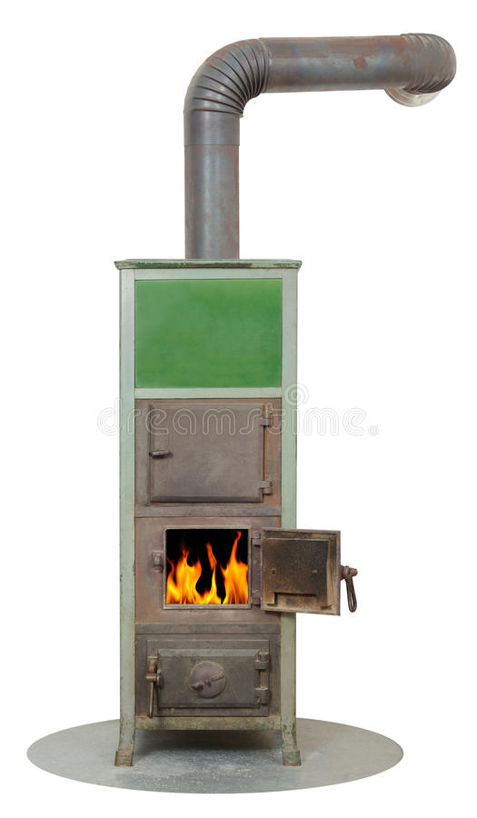 Heater. Burning wood fired masonry heater stock photo
