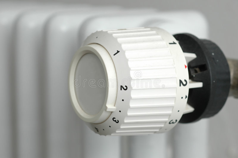 Heater. White heater thermostat close up stock photo