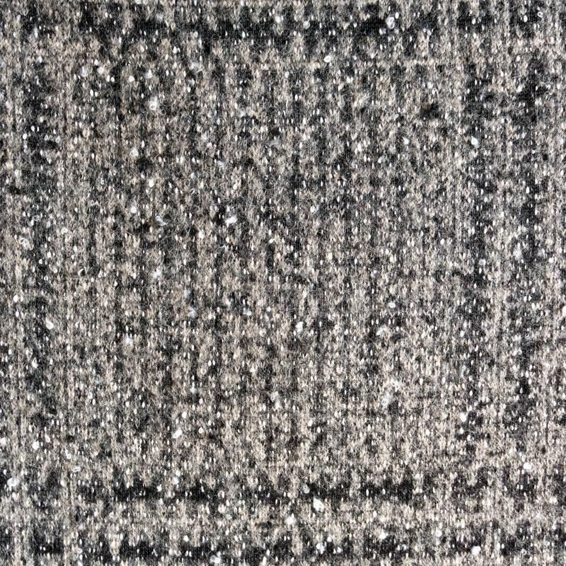 Heather knitted fabric made of wool fibres textured background. stock photo