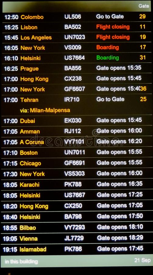 Heathrow airport departure board. Afternoon departure board at heathrow airport, with international flights closing, boarding, and showing a go to gate royalty free stock photo