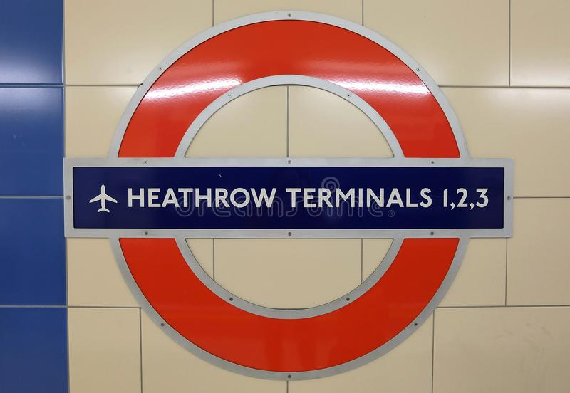 Heathrow airport metro sign. London, UK 05.02.2016 Metro (tube) logo on a station for Heathrow Airport Terminals 1,2,3. For arrivals and departures royalty free stock photo