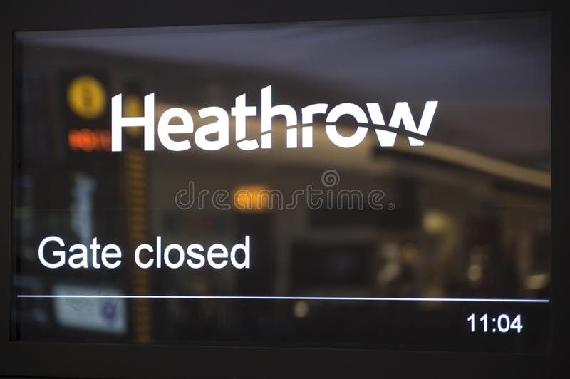 Heathrow airport. Time table display gate closed royalty free stock images