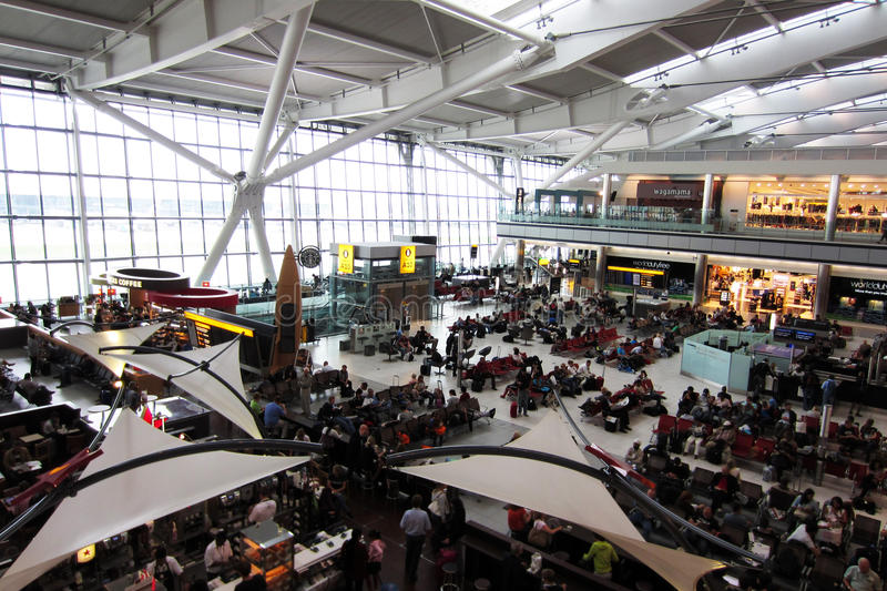 Heathrow Terminal 5. Passengers waiting for flights in new Terminal 5 at Heathrow Airport London stock images