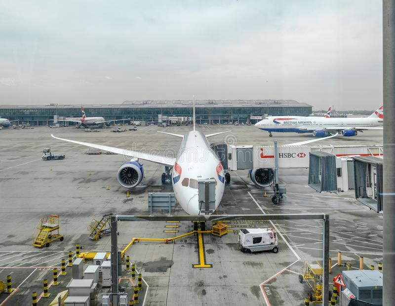 Heathrow Terminal 5, London, UK- September 25, 2017: View from t. He plane window of British Airways plane being prepared for next journey. Misty morning shot royalty free stock photos