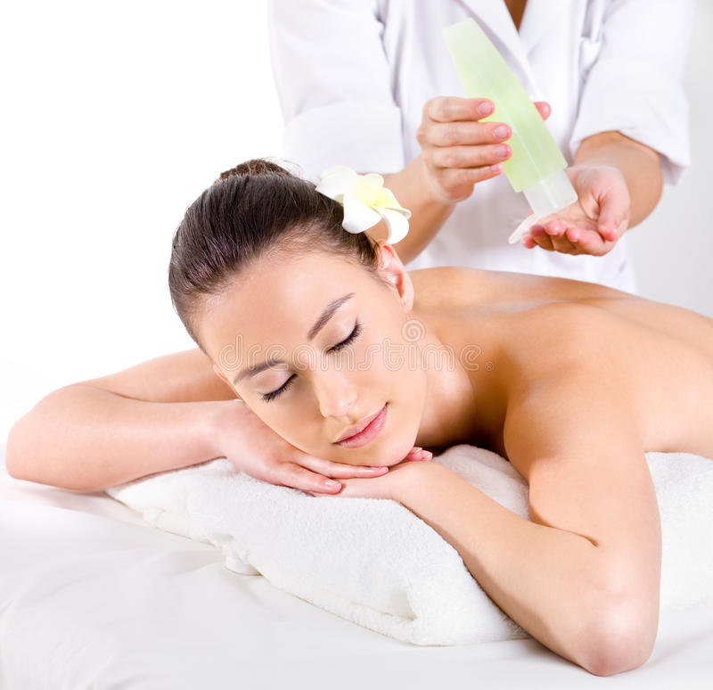 Heathy massage for young woman with aromatic oils stock image
