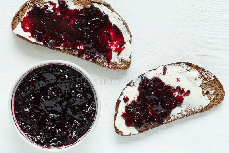 Heathy whole wheat toast with butter and jam on stock image