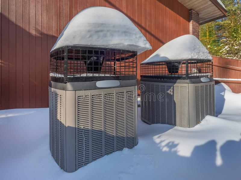 Heating and air conditioning units used to heat and cool a house. Heating and air conditioning inverter used to heat a house in winter royalty free stock photos