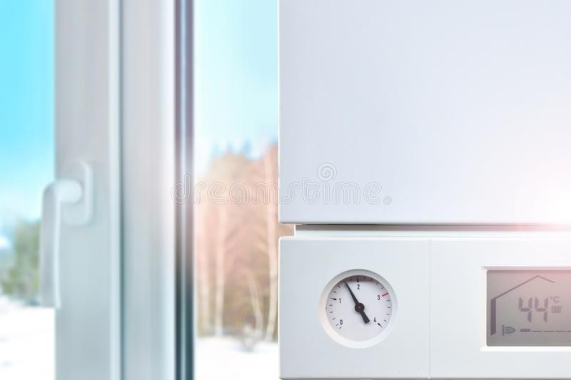 Heating boiler in a house. Warmth and comfort at home stock photography
