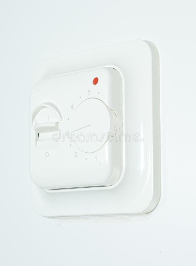 Heating controller. A heating controller on white background stock image