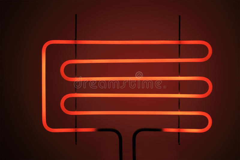 Heating element. Of a small electrig barbeque grill glowing stock photography