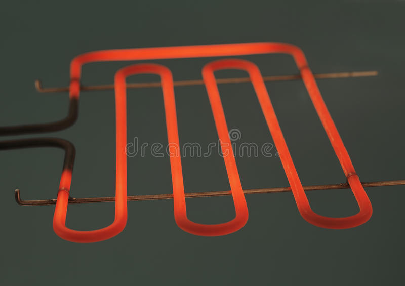 Heating element. Of a small electrig barbeque grill glowing stock image