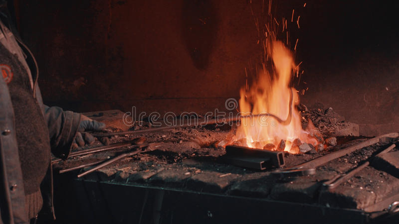 Heating of metal detail in the fire. Close up of heating of metal detail in the fire royalty free stock image