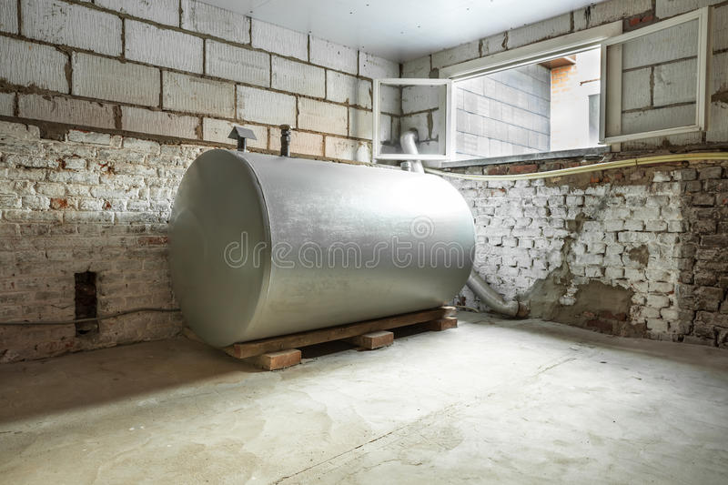 Heating oil tank. In a separate room in a old building, there is a heating oil tank stock images