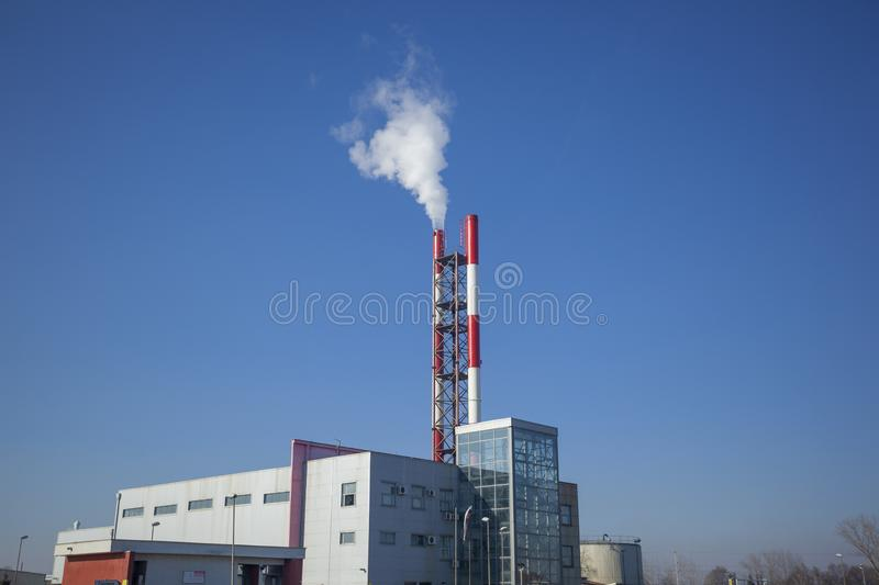Heating plant - powerhouse and chimey with smoke. Make heat energy for city in winter royalty free stock photos