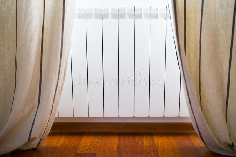 Heating radiator in cozy room. Closeup view royalty free stock photo