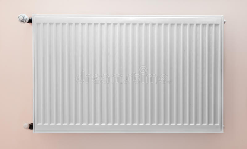 Heating system. Attached to wall frontal with hardwood floor royalty free stock photo